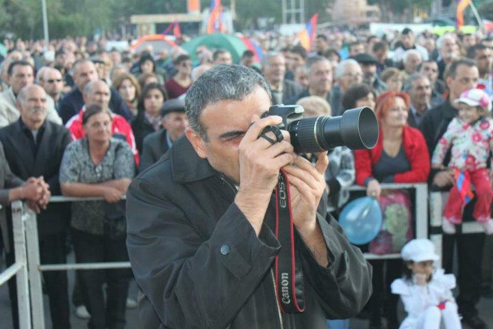 Armenia -- Journalist Hayk Gevorgyan covers and opposition rally, Yerevan, undated