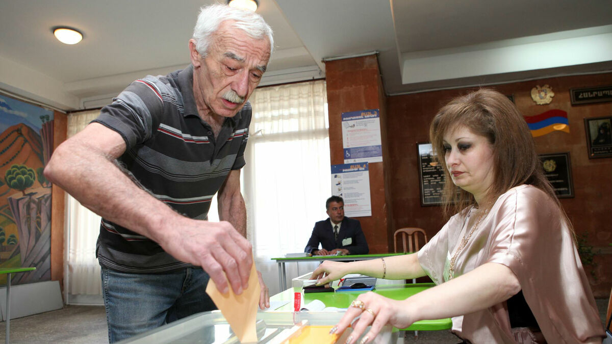 Armenia - A man is casting his ballot in the parliamentary elections in Armenia, Yerevan, 06May2012   Photolure