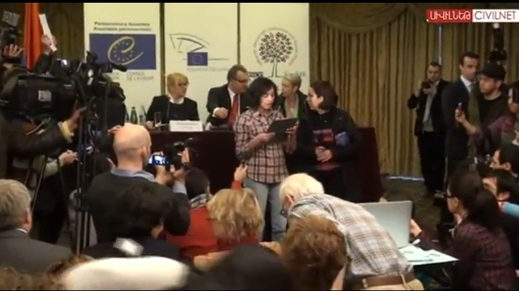 Lena Nazaryan reads her statement during the press conference. | Via Armenianweekly.com