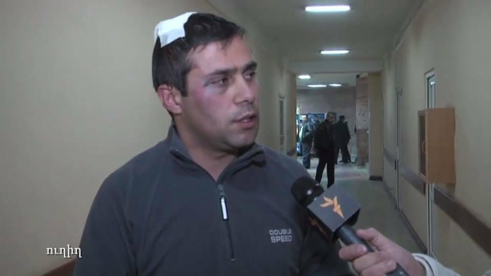 Armenia -- Civic Activist, PreParliament member Gevorg Safarian talks to RFE/RL shortly after the attack, Yerevan, 27Nov2014